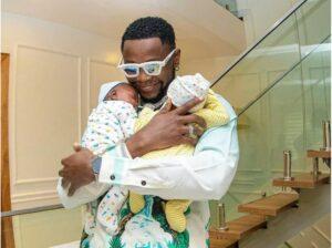 Kizz Daniel buys a penthouse each for his baby boys